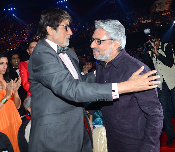 Amitabh Bachchan hugs his film Black's director, Sanjay Leela Bhansali who won the Best Director award for Bajirao Mastani.