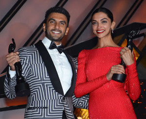 Off screen couple Ranveer Singh and Deepika Padukone pose with their trophy.