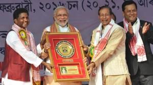 Prime Minister Narendra Modi being presented a memento at the 85th Annual Conference of Srimanta Sankaradeva Sangha, at Sibasagar, Assam on February 05, 2016. (Source: PIB)